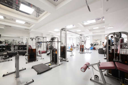 Foto de interior of new modern gym with equipment - Imagen libre de derechos