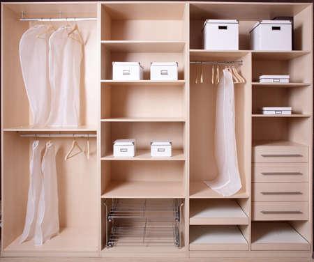 Photo pour modern and stylish interior of bright wooden wardrobe - image libre de droit