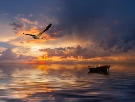 Photo pour Beautiful landscape with lonely boat and birds against a sunset, majestic clouds in the sky - image libre de droit