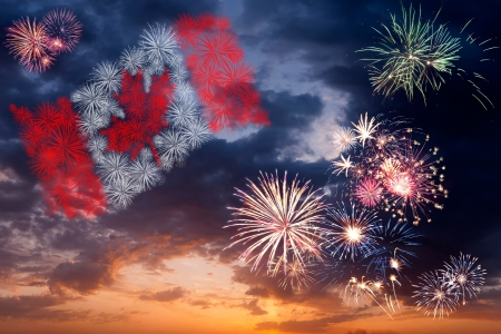 Beautiful colorful holiday fireworks with national flag of Canada, evening sky with majestic clouds