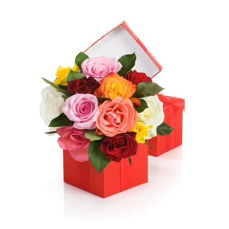Red gift box with colorful roses on white background