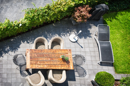 Photo for Sunny patio with table and chairs, high angle view - Royalty Free Image