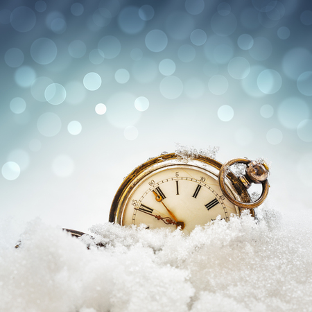 New year clock before midnight. Antique pocket watch in the snow