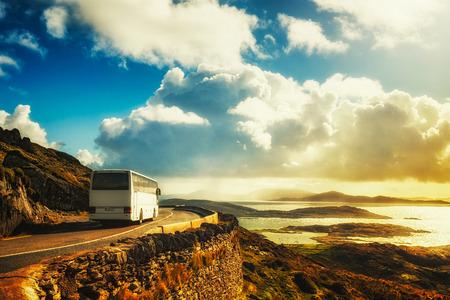 Photo pour Tourist white bus on mountain road. Ring of Kerry, Ireland. Travel destination - image libre de droit