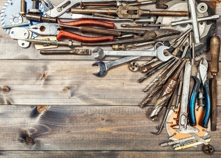 Tool background. Old vintage metal tools collection on wooden workbench. Copy space. Top view, flat lay