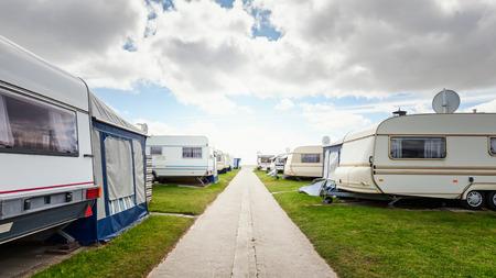 Foto de Caravan camping on the beach. Family vacation in caravan park. North sea coast, Germany  - Imagen libre de derechos