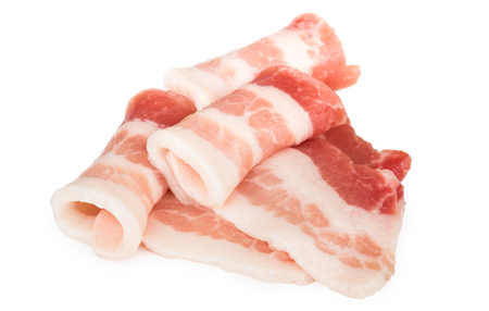 Photo pour Heap of rolled pieces raw bacon isolated on white background - image libre de droit