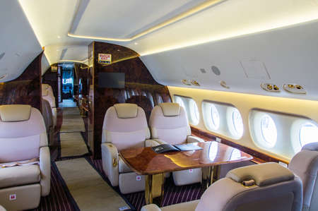 Photo pour Luxury interior of genuine leather in the modern business jet - image libre de droit