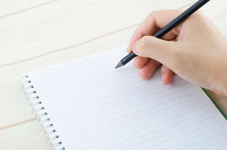 Photo pour hand writing on notebook - image libre de droit