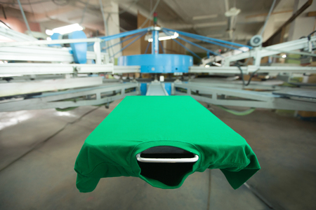 Green t-shirt silk screen printing machine, look of the mock up tshirt before printing process, horizontal image