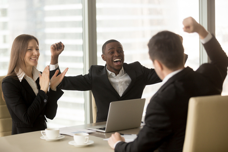 Photo pour Happy excited multi-ethnic business team in formal wear celebrating victory, raising hands and applauding, unexpected win, stock trading success, impressive achievement, great luck, yes we did it - image libre de droit