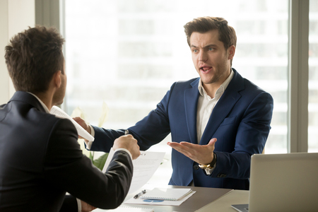 Photo for Businessmen arguing at workplace, disagreeing over document, partners having conflict while negotiating, business deal failure, agreement cancelation, breaking contract, unacceptable terms - Royalty Free Image