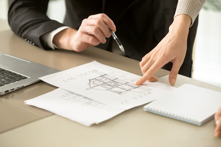 Photo pour Close up view of two-story house construction project, architects discuss home building architectural plan, agents determine price of real estate object for sale, property value estimation appraisal - image libre de droit