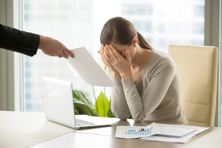 Male hand gives sad depressed businesswoman document with bad news, upset desperate entrepreneur gets dismissal notice, hiding crying face, frustrated by bankruptcy, business failure or got fired