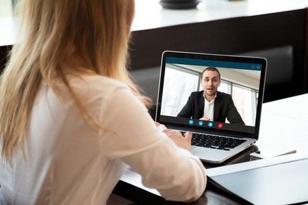 Photo pour Businesswoman making video call to business partner using laptop, looking at screen with virtual web chat, contacting client by conference, talking on webcam, online consultation, hr concept, close up - image libre de droit