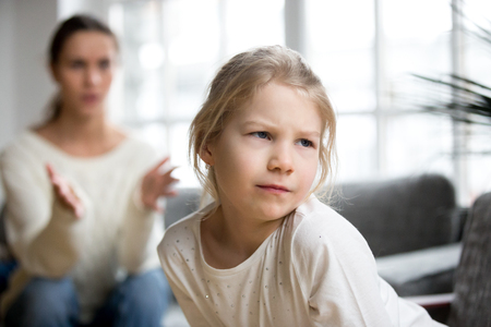 Photo pour Sulky angry offended kid girl pouting ignoring mother scolding her for bad behavior, stubborn insulted daughter not listening to mom disagreeing with punishment, family conflicts child rebuke concept - image libre de droit