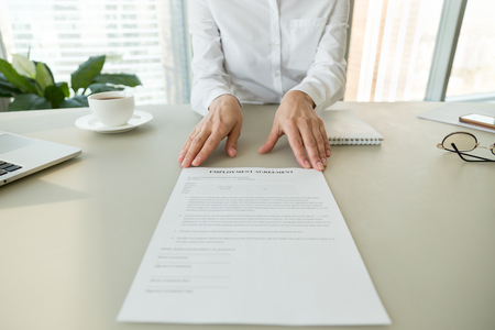 Photo pour Female hr or employer offering employment agreement document for reading labor contract terms and work conditions, hiring new employee process and getting job, recruitment concept, close up view - image libre de droit