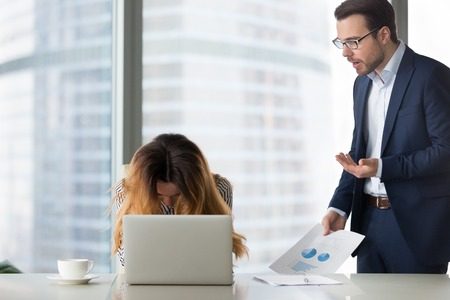 Foto de Dissatisfied boss argue shouting at young desperate woman. Director blaming subordinate for mistakes. Too much work, suffers from exhaustion, deadline. - Imagen libre de derechos