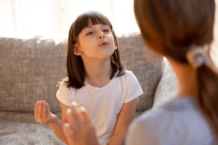 Foto de Cute stuttering child girl speaking learning correct articulation or singing warm-up with speech therapist music teacher doing exercises at private lesson, speech language therapy for kid concept - Imagen libre de derechos