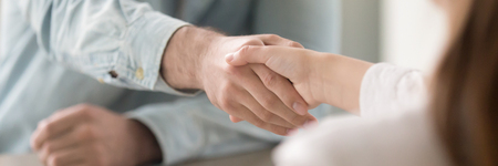 Photo pour Businessman shaking hands with businesswoman, client and agent greeting gesture. Two people handshaking expressing respect and trust concept. Horizontal close up photo banner for website header design - image libre de droit