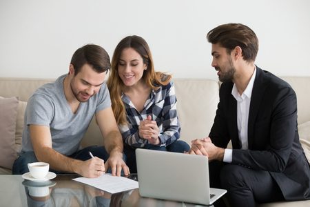 Photo pour Happy family couple customers renters tenants sign mortgage loan investment agreement or rental sale purchase contract meeting lender or landlord making real estate ownership deal concept. - image libre de droit