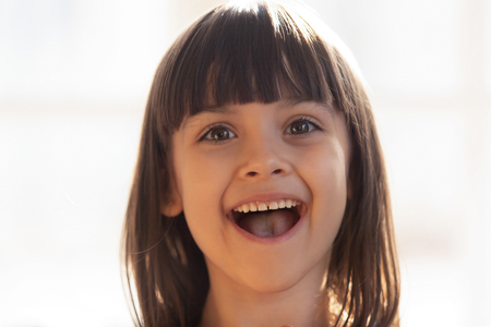 Photo pour Close up portrait funny little happy preschool girl open mouth cheerful happy and overjoyed facial expressions. Adorable daughter kid face healthy child, carefree childhood, innocence beauty concept - image libre de droit