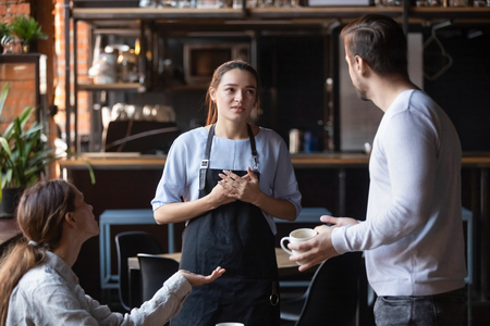 Photo pour Hostile angry restaurant client couple or friends talking with waiting staff in public place complains about cold coffee long service, spoiled tasteless dish waitress feels guilty mixed orders concept - image libre de droit
