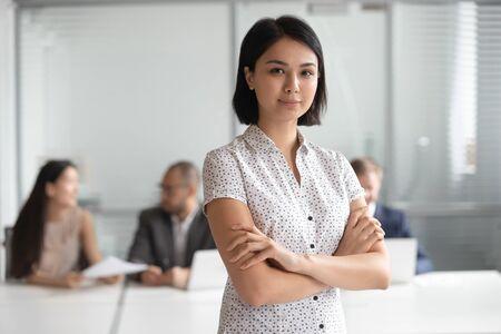 Head shot photo of confident serious pleasant korean female executive manager portrait. Happy adorable asian businesswoman, team leader, professional, consultant, financial advisor, bank worker, intern