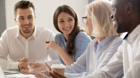 Photo pour Diverse smiling colleagues have fun sit in office laugh chatting at coffee break, happy multiethnic employees speak discussing or sharing ideas, enjoy casual briefing or meeting at workplace - image libre de droit