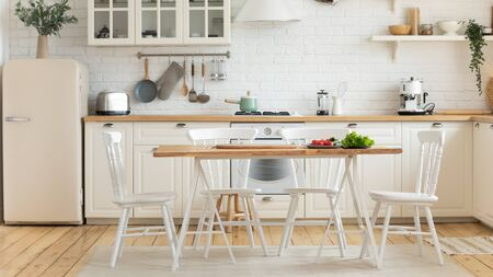 Photo pour Modern cozy domestic kitchen interior, on dining table fresh vegetables homeowners prefers healthy food, loan mortgage new studio flat for rent, furnishing advertisement, renovation services concept - image libre de droit