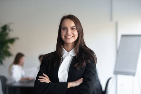 Photo for Head shot portrait of smiling businesswoman in elegant formal suit stands with arms crossed pose for picture at workplace, representative of young skilled professional, empowerment, leadership concept - Royalty Free Image
