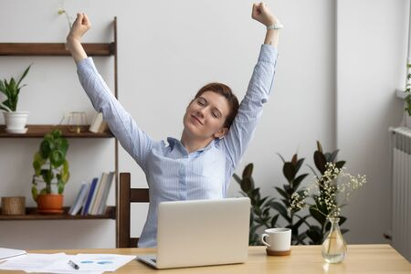 Photo pour Satisfied businesswoman stretching at workplace after finished work, sitting in comfortable chair, happy employee with closed eyes relaxing during break, breathing deep, feeling no stress - image libre de droit