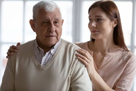 Photo pour Caring grown up granddaughter express sympathy stroking elderly grandfather related to senile disease memory loss, mental disorder or dementia. Caregiving older generation people nursing home concept - image libre de droit