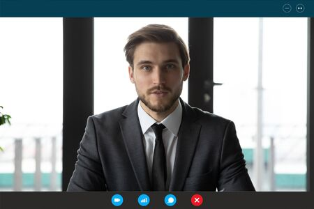 Photo pour Headshot portrait screen application view of young businessman talk on video call with business client online, millennial male employee worker engaged in webcam briefing conference in office - image libre de droit