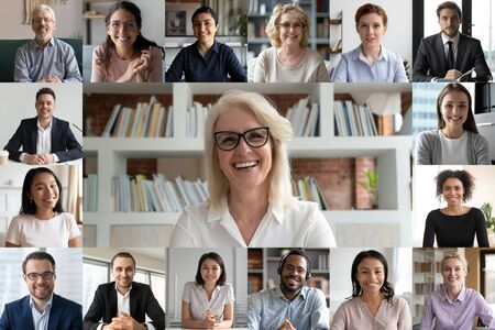 Photo pour Webcam pc screen view during group video call, many faces diverse colleagues participating in on-line meeting led by mature 50s businesslady, e-coaching, video conferencing, worldwide app easy usage - image libre de droit