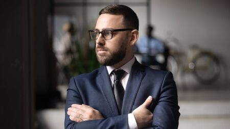 Photo pour Serious Caucasian businessman in glasses look in distance thinking or visualizing, thoughtful middle-aged male boss lost in thoughts pondering over problem solution, plan, business vision concept - image libre de droit