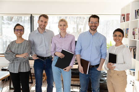 Photo for Portrait of smiling multiracial businesspeople posing together in office, show unity and support in work, happy diverse multiethnic employees professional workers look at camera, employment concept - Royalty Free Image
