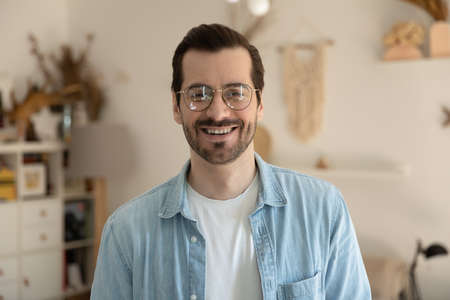 Photo pour Profile picture of smiling young Caucasian man in glasses show optimism positive and motivation, headshot portrait of happy millennial male client customer in spectacles satisfied with good service - image libre de droit