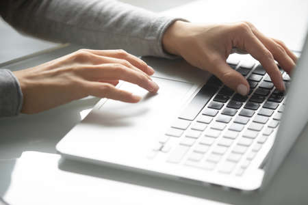 Photo pour Workday in office. Close up of hands of millennial businesswoman worker employee client customer using laptop typing on portable computer keyboard searching information in internet working online - image libre de droit