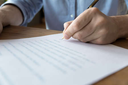 Photo pour Man hand signing contract job agreement, close up view. Male client putting signature on legal document, take loan or mortgage in bank, real estate purchase, insurance or investment, make deal concept - image libre de droit