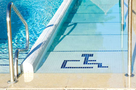 Access to swimming pool for with handicapped symbol
