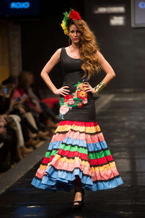 "JEREZ DE LA FRONTERA, SPAIN - FEBRUARY 14: Models pictured on the catwalk during the ""Carmen Rojo� Flamenca season fashion show at Pasarela Flamenca Jerez on feb 12, 2015 in Jerez de la frontera."