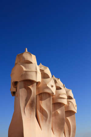 On the terrace of the Casa Mila (also called La Pedrera) is a cross-shaped chimneys and soldiers of anthropomorphic forms created by Antonio Gaudi. It was created in 1905. Photo background.