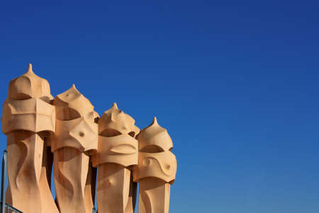 Barcelona & Gaudi. On the terrace of the Casa Mila (also called La Pedrera) is a cross-shaped chimneys and soldiers of anthropomorphic forms created by Antonio Gaudi. It was created in 1905. Photo background.