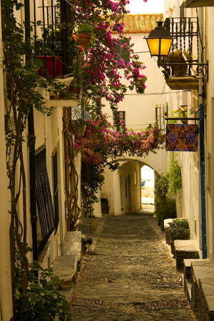 Dawn. Narrow street in a small Mediterranean village. Cadaques, Costa Brava, Catalonia, Spain