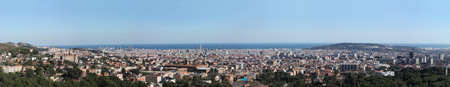 Great overview of Barcelona. Large Format. One can observe in detail the Agbar Tower, La Sagrada Famila, the mountain of Montjuic, the Calatrava Tower, or the Nou Camp football stadium