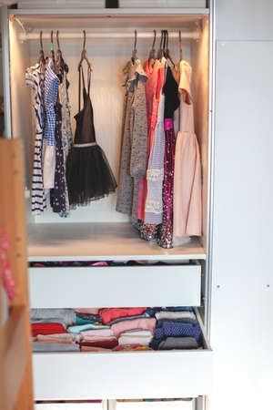 Photo pour Vertical storage of clothing. childrens room. Clothing folded for vertical storage in the linen drawer. Nursery. Sliding wardrobe. Room interior. Neatly folded clothes in chest of drawers. - image libre de droit