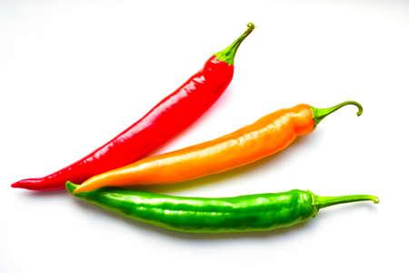 Foto für Regular and capsicum yellow and green pepper on a white background - Lizenzfreies Bild