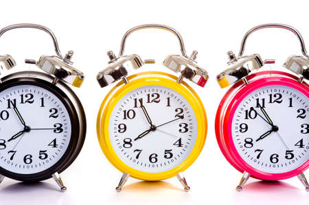 a group of multicolor clocks on a white background with copy space