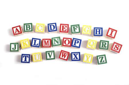 Photo pour A child's alphabet blocks on a white background - image libre de droit